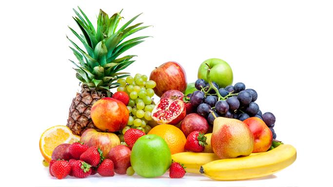 Auf diesem Bild sehen Sie viele verschiedene Früchte.  (Äpfel, Birnen, Erdbeeren, Bananen, Trauben, Annanas, Zitronen, Granatäpfel, Pfirsich)